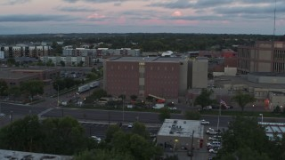 DX0002_176_040 - 5.7K stock footage aerial video of orbiting a county government building at twilight, Downtown Sioux Falls, South Dakota