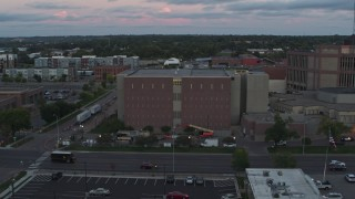 DX0002_176_041 - 5.7K stock footage aerial video of a county government building at twilight, Downtown Sioux Falls, South Dakota
