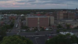 DX0002_176_042 - 5.7K stock footage aerial video of an orbit of a county government building at twilight, Downtown Sioux Falls, South Dakota