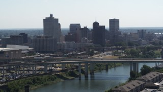 DX0002_177_004 - 5.7K stock footage aerial video stationary view of the city's skyline and bridge before descent in Downtown Memphis, Tennessee