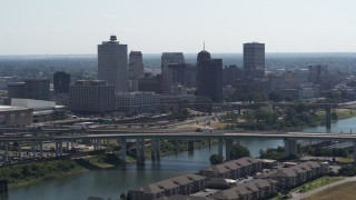 DX0002_177_010 - 5.7K stock footage aerial video a view of the skyline, and bridge spanning the river in Downtown Memphis, Tennessee
