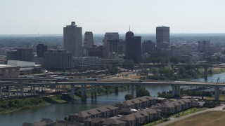 DX0002_177_011 - 5.7K stock footage aerial video of the skyline, and bridge spanning the river in Downtown Memphis, Tennessee