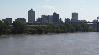DX0002_177_014 - 5.7K stock footage aerial video ascend from river for view of the skyline and bridge, Downtown Memphis, Tennessee