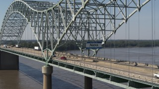 DX0002_177_023 - 5.7K stock footage aerial video ascend from river, approach sign on the bridge, Memphis, Tennessee