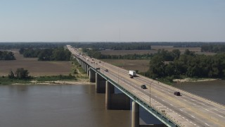 DX0002_177_025 - 5.7K stock footage aerial video ascending from the bridge to Arkansas spanning the Mississippi River