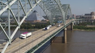 DX0002_177_027 - 5.7K stock footage aerial video of cars crossing the bridge to Memphis, Tennessee