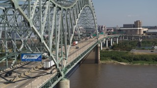 DX0002_177_028 - 5.7K stock footage aerial video of following cars crossing the bridge to Memphis, Tennessee