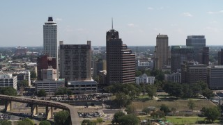 DX0002_177_041 - 5.7K stock footage aerial video of a tall office tower with spire in Downtown Memphis, Tennessee