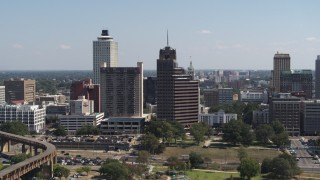 DX0002_177_042 - 5.7K stock footage aerial video stationary view of a tall office tower with spire in Downtown Memphis, Tennessee