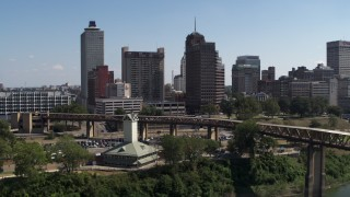 DX0002_178_004 - 5.7K stock footage aerial video flyby welcome center with view of the skyline in Downtown Memphis, Tennessee