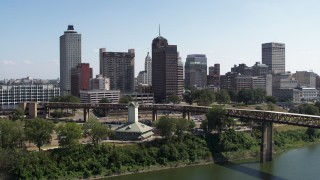 DX0002_178_011 - 5.7K stock footage aerial video ascend over river toward office towers in the Downtown Memphis, Tennessee skyline