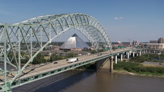 DX0002_178_022 - 5.7K stock footage aerial video flying by cars crossing the bridge to Memphis, Tennessee, reveal Memphis Pyramid