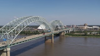 DX0002_178_026 - 5.7K stock footage aerial video of an orbit of light traffic traveling on the bridge, Memphis, Tennessee