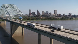 DX0002_178_033 - 5.7K stock footage aerial video flyby bridge traffic with a view of the skyline of Downtown Memphis, Tennessee