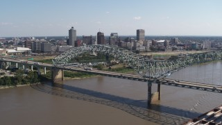 DX0002_178_042 - 5.7K stock footage aerial video descend with a view of the bridge and the skyline of Downtown Memphis, Tennessee