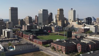 DX0002_179_004 - 5.7K stock footage aerial video descend with view of tall office towers and a baseball stadium in Downtown Memphis, Tennessee