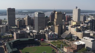DX0002_179_007 - 5.7K stock footage aerial video of orbit two tall office towers and fly away for view of a baseball stadium in Downtown Memphis, Tennessee