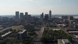 DX0002_179_032 - 5.7K stock footage aerial video ascend and approach high-rise office buildings in Downtown Memphis, Tennessee skyline
