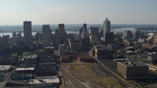 DX0002_179_035 - 5.7K stock footage aerial video descending past tall high-rise office buildings in Downtown Memphis, Tennessee skyline