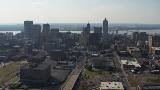 DX0002_179_037 - 5.7K stock footage aerial video fly away from tall high-rise office buildings in the Downtown Memphis, Tennessee skyline, descend