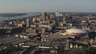 DX0002_180_023 - 5.7K stock footage aerial video of a view of FedEx Forum arena and the city skyline at sunset, Downtown Memphis, Tennessee