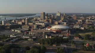 DX0002_180_025 - 5.7K stock footage aerial video of a view of the city skyline seen while flying away from FedEx Forum arena, sunset, Downtown Memphis, Tennessee