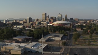 DX0002_180_027 - 5.7K stock footage aerial video ascend toward the city skyline and FedEx Forum arena at sunset, Downtown Memphis, Tennessee