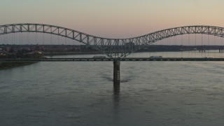 DX0002_181_018 - 5.7K stock footage aerial video a view of traffic crossing the Hernando de Soto Bridge at sunset, Downtown Memphis, Tennessee