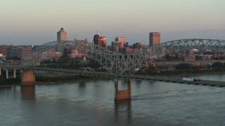 DX0002_181_021 - 5.7K stock footage aerial video of the city's skyline as traffic crosses the bridge at sunset, Downtown Memphis, Tennessee