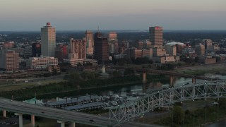 DX0002_181_023 - 5.7K stock footage aerial video of the city's skyline seen from the Hernando de Soto Bridge at sunset in Downtown Memphis, Tennessee