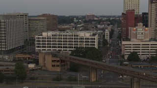 DX0002_181_035 - 5.7K stock footage aerial video of orbiting Memphis City Hall at sunset in Downtown Memphis, Tennessee