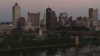 DX0002_181_038 - 5.7K stock footage aerial video fly away from and by apartment and office high-rises at sunset in Downtown Memphis, Tennessee