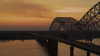 DX0002_181_044 - 5.7K stock footage aerial video fly beside the Hernando de Soto Bridge at sunset, Arkansas