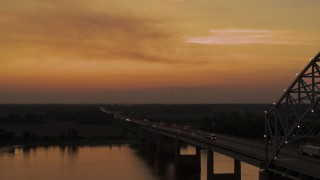 DX0002_181_045 - 5.7K stock footage aerial video fly beside the Hernando de Soto Bridge at sunset, approach Arkansas