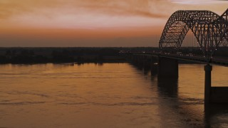 DX0002_181_048 - 5.7K stock footage aerial video of the Hernando de Soto Bridge at sunset and the Arkansas side of the bridge