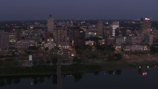 DX0002_182_006 - 5.7K stock footage aerial video of a reverse view of downtown from across the river at twilight in Downtown Memphis, Tennessee
