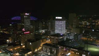 DX0002_182_035 - 5.7K stock footage aerial video stationary view of One Commerce Square and First Tennessee Building at night in Downtown Memphis, Tennessee