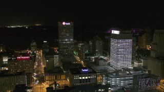 DX0002_182_038 - 5.7K stock footage aerial video approach One Commerce Square by First Tennessee Building at night in Downtown Memphis, Tennessee