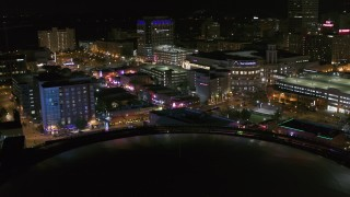 DX0002_182_040 - 5.7K stock footage aerial video of restaurants and clubs on Beale Street at night in Downtown Memphis, Tennessee