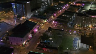 DX0002_182_045 - 5.7K stock footage aerial video fly toward Beale Street and BB King Boulevard intersection at night in Downtown Memphis, Tennessee