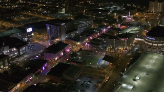 DX0002_182_048 - 5.7K stock footage aerial video fly toward intersection of Beale Street and BB King Boulevard at night in Downtown Memphis, Tennessee