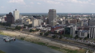 DX0002_183_003 - 5.7K stock footage aerial video of reverse view of One Commerce Square and office buildings, Downtown Memphis, Tennessee