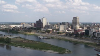 DX0002_183_004 - 5.7K stock footage aerial video of flying by and away from the city's skyline, Downtown Memphis, Tennessee