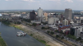 DX0002_183_007 - 5.7K stock footage aerial video fly past and away from the city's skyline in Downtown Memphis, Tennessee