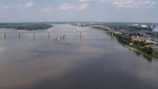 DX0002_183_010 - 5.7K stock footage aerial video a wide orbit of the Hernando de Soto Bridge and Mississippi River, Memphis, Tennessee