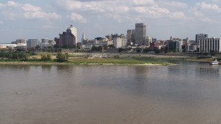 DX0002_183_011 - 5.7K stock footage aerial video flying low toward the city's skyline in Downtown Memphis, Tennessee