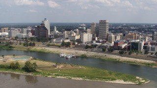 DX0002_183_013 - 5.7K stock footage aerial video flying away the city's skyline to the Mississippi River, Downtown Memphis, Tennessee