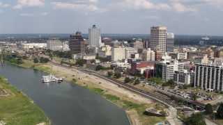 DX0002_183_017 - 5.7K stock footage aerial video orbit office buildings and fly away from Downtown Memphis, Tennessee