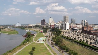 DX0002_183_018 - 5.7K stock footage aerial video the city's skyline and Wolf River Harbor during descent, Downtown Memphis, Tennessee