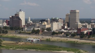 DX0002_183_024 - 5.7K stock footage aerial video of city buildings between office towers, Downtown Memphis, Tennessee